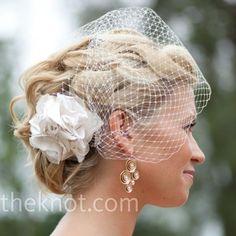 flower and birdcage veil