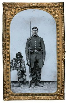 Unidentified soldier in Union frock coat with bayoneted musket next to infantry Hardee hat with plume on table.  Liljenquist Family Collection of Civil War Photographs at Library of Congress.