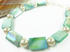 Soft and feminine blue and white colors to wear around your ankle for summer. Perfect to take with you on those mid-winter vacations to warmer weather. This stylish ankle bracelet is made with turquoise colored rectangle shape mother of pearl b...
