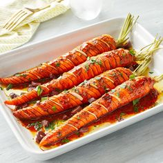 Take roasted carrots to the next level with this hasselback version of a vegetable-side favorite. Adding thin hasselback cuts to whole carrots not only allows more flavor to seep into the veggies, it also speeds up the cooking time. (only fruit recipes) Carrot Recipes, Vegan Recipes, Zone Recipes, Superfood Recipes, Dishes Recipes, Vegan Foods, Vegan Dishes, Fruit Recipes, Vegetable Sides