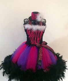 All tutus are custom made to order. I specialize in Halloween costumes and theme birthday tutus. These make great gifts for any occasion and