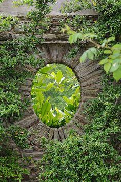 Edwin Lutyens & Gertrude Jekyll garden with a peek to what's beyond.