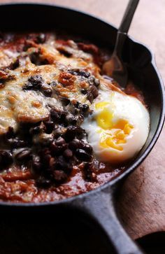 These black bean chilaquiles make for a deeply savory and VERY spicy breakfast for dinner. Layers of crispy fried tortillas, black bean chili, cheese and a red mole sauce make it HOT HOT HOT.