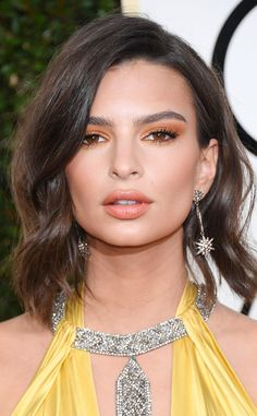 Emily Ratajkowski from 2017 Golden Globes' Best Beauty Looks The supermodel didn't stray too far from her classic all-over bronzed look, this time with a pop of orange.