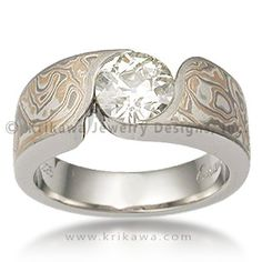 Mokume Wave Engagement Ring - Round - An organically shaped mokume band that is contoured to a variety of  stone shapes. This engagement ring's stone is flush set to the band, which thickens toward the  top of the finger to allow for the depth of the stone.