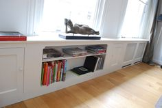 Radiator bookcase cover.