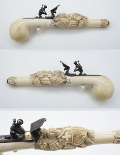 Ivory stock flintlock pistol, 18th or 19th century. Features carvings of Swiss and Knights Templar symbols