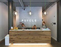 Psycle gym reception desk. Original Plumen 001 Light Bulbs.