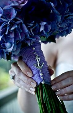 """You don't have to scream """"nautical"""" with white, navy, and stripes to achieve this seaside look. This bride used lilacs accented with an ancor charm that look simply seaside chic."""