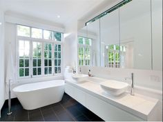 Love this bathroom, nice way of including bath but also lots of vanity room for storing toiletries etc which can be hard to do in a qlder