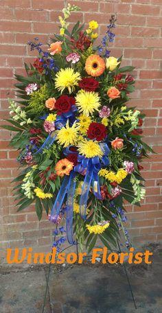Bright Colors, spider mums, roses, gerbera daisies & carnations