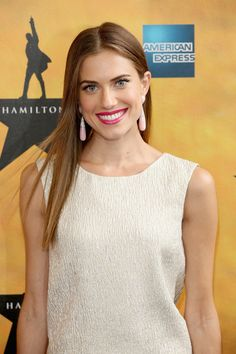 Allison Williams wears a silvery-white textured pants outfit by Oscar de la Renta with pearlized drop earrings and a pink lip at the Broadway premiere of Hamilton in N.Y.C.