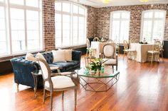 Lounge Area with Navy Tufted Sofa + Cream Accent Chairs | Classic Southern Wedding at the Rice Mill | Dana Cubbage Weddings, Charleston SC Wedding Photography