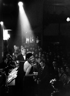 Billie Holiday performs before a white audience.