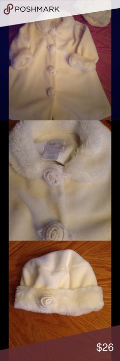 Sophie Rose white toddler coat w/ matching hat Beautiful coat has velcro closures and cuffed long sleeves. Lightweight fleece construction offers an added layer of warmth. Matching hat completes the look. Polyester, acrylic.  Machine wash.  Worn a few times!   EXCELLENT CONDITION!     Like New!    Sophie Rose Jackets & Coats