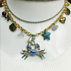 Betsey Johnson Blue Jeweled Crab Necklace ADORABLE! Betsey Johnson Blue Enamel Jeweled Crab Necklace. Featuring Gold Tone Chain, Nautical Charms & Beads. VERY CUTE! Betsey Johnson Jewelry Necklaces