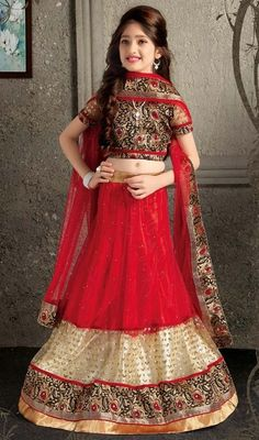 Amaze your onlookers draping this lehenga choli for girl in red color net. Look ravishing clad with this attire that is enhanced lace work. Upon request we can make round front/back neck and short 6 inches sleeves regular lehenga blouse also. #RedAlineLehengaCholi