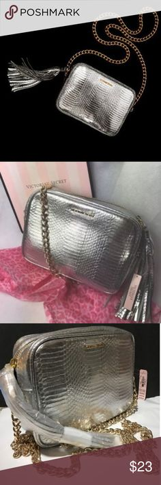 """Victoria Secret Silver Crossbody Bag Product Details  As seen on the runway and backstage at the Victoria?s Secret Fashion Show in Paris, this crossbody bag adds a touch of Angel glamour to any outfit.  PRODUCT DETAILS: √ 7"""" L x 2"""" W X 6"""" H √ Imported polyurethane   NO PayPal NO Trades NO Low-Balling...     &  free House....   ALL Offers are Welcome via Offer Feature... ✅ Victoria's Secret Bags Crossbody Bags"""