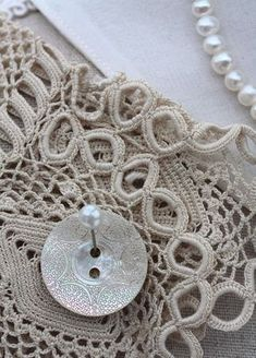 beautiful carved mother of pearl button and lace