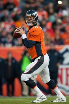 DENVER, CO - DECEMBER 23: Quarterback Peyton Manning #18 of the Denver Broncos passes against the Cleveland Browns during a game at Sports Authority Field Field at Mile High on December 23, 2012 in Denver, Colorado. The Broncos defeated the Browns 34-12. (Photo by Dustin Bradford/Getty Images)