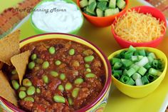 "Crockpot Mexican Jumping Bean Chili...Gosh knows there are gazillion versions of vegetarian chili ""out there."" What makes this one special is the addition of edamame to the chili bean mix which adds just a hint of crunch and a pretty bright green color. And this chili is so aptly named because the edamame look like they just want to jump right out of the pot, bringing back memories of the Mexican jumping beans we played with as kids."