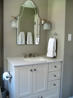 Hallway bath reno - questions answered! Mirror from Lowes with Home Depot vanity and Silestone Lagoon top.