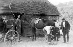 Old photograph of a soldier outside the cottage of a Blacksmith in Highland Perthshire, Scotland