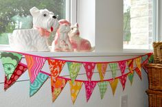 "Amy Butler - Heather Bailey fabric ""mini"" banner bunting, birthday party decoration, photo prop. $30.00, via Etsy."