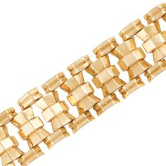 Wide Gold Bracelet  18 kt., centering a line of faceted bow links, edged by pairs of beveled bar links, with French import mark, circa 1940, missing thumbpiece, approximately 54.2 dwts. Length 7 1/4 inches.