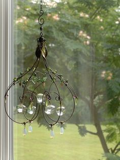 A Melted Marble Sunshower Chandelier by Cassie Bell Sculpture Romaine, Wire Chandelier, Chandeliers, Copper Wire Crafts, Barbed Wire Art, Wire Ornaments, Deco Nature, Diy Wind Chimes, Beads And Wire