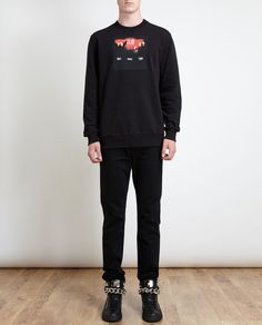 """Black cotton sweatshirt with abstract red and orange alarm clock print on chest from Givenchy. Joe is 190 cm/6'2"""" and is wearing a Size XS •Centre back: 72.5 cm/28.5 inches •Chest: 58.5 cm/23 inches •Waist: 49.5 cm/19.5 inches •Shoulder: 47 cm/18.5 inches •Arm length: 66 cm/26 inches •Standard Sizing RRP: £360 (browns fashion)"""