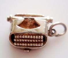 Nuvo Vintage Silver Typewriter Charm opens to a Letter. £34.00, via Etsy.