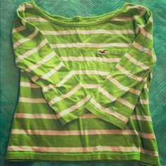 Hollister Lime Green and White Striped Tee Size M short tee with front pocket and 3/4 length sleeves - 100% cotton - bottom hits right at the top of pants Hollister Tops Tees - Long Sleeve
