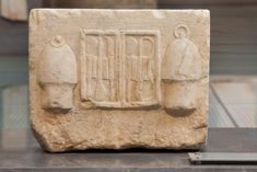 The sanctuary of Asclepios | Acropolis Museum. Base of a dedication On the relief are presented a case with surgical tools and bowls for cupping (sikyai). Around 320 BC (NAM 1378)
