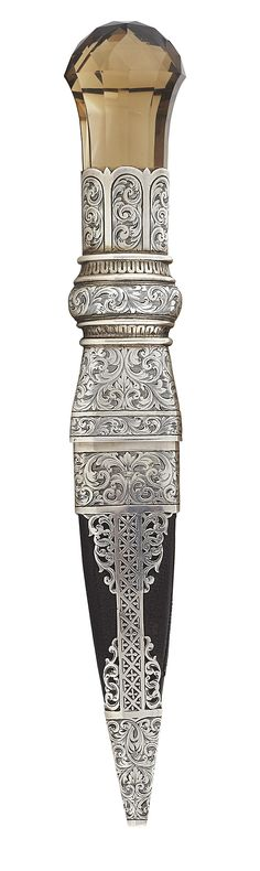 A fine Edwardian sgian dubh  R & H B Kirkwood, Edinburgh 1904, the finely engraved foliate scrolled silver handle with large flared and domed facetted citrine handle, the leather covered scabbard with engraved and pierced floral scroll mounts.  19.8cm long