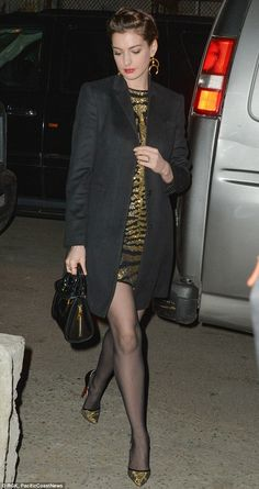 Anne Hathaway looked stunning in a pair of gold and black Louboutin spiked heels as she stepped out to a friend's wedding on Saturday evening in Brooklyn