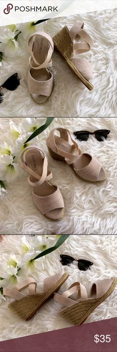 Ellen Tracy Eldon Espadrille Wedge Sandals These gorgeous Ellen Tracy wedge sandals have been worn once (see excellent soles). Pair with cuffed skinny jeans or flouncy sun dress. Features elastic straps and 3.25 inch heel. Excellent condition! Size: 6. Ellen Tracy Shoes Espadrilles