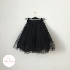 A beautiful detail of our over-knee black hand-tied white tutu skirt inspired by prima ballerina's.  This version is over-knee length and is triple layered for extra volume, the bodice is stretchy to enable a perfect fit.  Upkeep - hand wash & iron inside out
