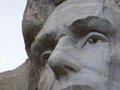 The pupils of Mount Rushmore's president's eyes have cubes of stone carved into them to immitate light glinting