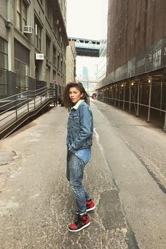 Zendaya wearing Levi's Sherpa Trucker Jacket, Nike Air Jordan 1 Retro High Banned Sneakers