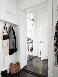 Scandinavian inspired entryway | Photo by Janne Olander, styling by Emma Fischer via Stadshem