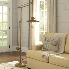 Linwood Floor Lamp | The Linwood Floor Lamp's brass finish and lantern-style shade create a distinguished look for your space. The pulley-style construction includes a swiveling arm so you can direct the light where needed.