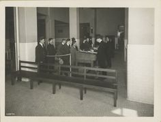 Ellis Island - Immigrants waiting in line for processing by Immigration Bureau officials. (1902-1913)