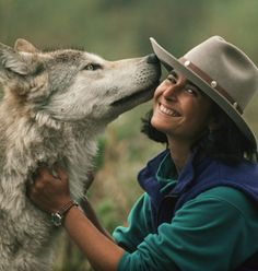 Jamie Dutcher. This woman is an inspiration to me with her work. I love this photo of her, both look happy - (littlewren).