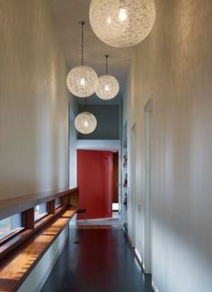 What better way to force the eye upward in a long narrow hallway than creating an installation of gorgeous Random Lights? - girls' hallway upstairs