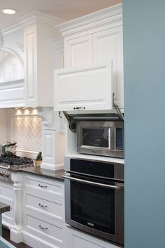 Our Favorite Ways to Hide An Ugly Microwave in Your Kitchen