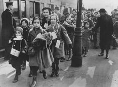 Austrian Jewish refugee children, members of one of the Childrens Transports (Kindertransporte), arrive at a London train station. Great Britain, February 2, 1939. Photograph from the United States Holocaust Memorial Museum.