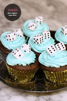 Here's a simple trick to spruce up your snacks for your board game night - just top your cupcake with (clean) dice! Just be sure to warn your guests that the toppers are not edible. (Not a suitable idea for a kids game night)