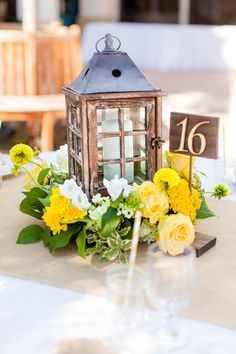 Lantern Centerpiece - PHOTO SOURCE • FIGLEWICZ PHOTOGRAPHY | Featured on WedLoft