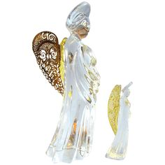 This is a group of Gorham Germany Crystal Angels .  One that is 6 and another 3 tall (the largest and the smallest) have beautiful filagree gold